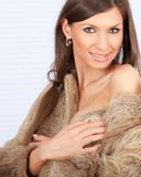 Young woman in a fur coat Royalty Free Stock Photography