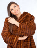 Young woman in a fur coat. Beautiful young woman in a fur coat Stock Photos