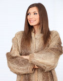 Young woman in a fur coat. Beautiful young woman in a fur coat Stock Photography