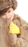 Young woman in a fur coat. Beautiful young woman in a fur coat, hat and yellow mittens Stock Photography