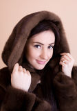 Young woman in fur coat Royalty Free Stock Photo