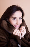 Young woman in fur coat Royalty Free Stock Photography