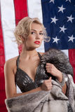 Young Woman In Fur Coat And American Flag Royalty Free Stock Image