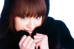 Young woman in fur coat Stock Photos