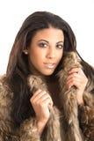 Young woman fur coat. Beautiful young woman fur coat royalty free stock image