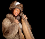 Young woman in a fur coat and hat Royalty Free Stock Image