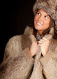 Young woman in a fur coat and hat Stock Image