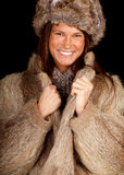 Young woman in a fur coat and hat, Stock Images