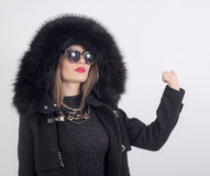 Young woman with fur coat Stock Image