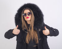 Young woman with fur coat. Young woman with fur hat, black sunglacess and redlips Royalty Free Stock Photos