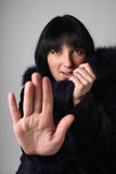 Young woman in fur coat making stop gesture Royalty Free Stock Photography