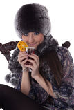 Young woman in fur with glass of mulled wine. Royalty Free Stock Photos