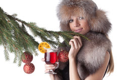 Young woman in fur with glass of mulled wine. Royalty Free Stock Photo