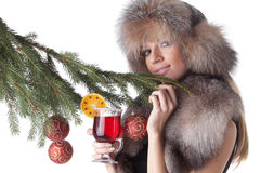Young woman in fur with glass of mulled wine. Royalty Free Stock Images