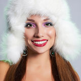 Young woman in fur hat Stock Image