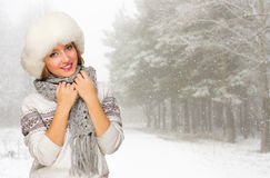 Young woman in fur hat at forest Stock Image
