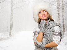 Young woman in fur hat at forest Royalty Free Stock Images