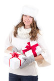 Young woman in fur hat with gift boxes isolated on white Royalty Free Stock Photo