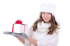 Young woman in fur hat with gift isolated on white Royalty Free Stock Image