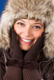 Young woman with fur hat and gloves laughs Royalty Free Stock Photos