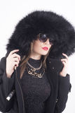 Young woman with fur hat Royalty Free Stock Photography