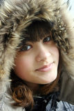 Young woman in fur head cloth Royalty Free Stock Photography