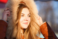 Young woman in fur hood. Close up winter portrait Stock Photography