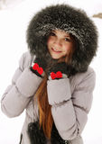 Young woman in a fur hood Stock Photos