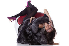 Young woman in fur with mobile phone Stock Images