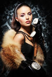 A young woman in fur talking on a vintage phone Royalty Free Stock Photo