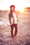 Young woman in fur vest. Girl wearing flur vest in winter field lifestyle photo Stock Image