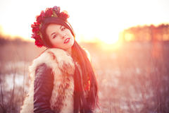 Young woman in fur vest. Girl wearing flur vest in winter field lifestyle photo Stock Images