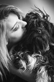 Young woman with furry cute dog. Black and white Stock Photography