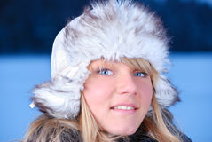 Young woman in furry hat royalty free stock photo