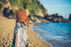 Young woman with furry hat on beach Stock Photo