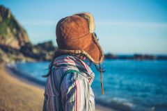 Young woman with furry hat on beach Royalty Free Stock Images