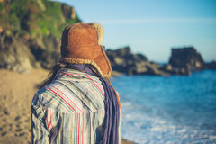 Young woman with furry hat on beach Royalty Free Stock Photography