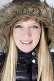 Young woman in furry hood Royalty Free Stock Photo