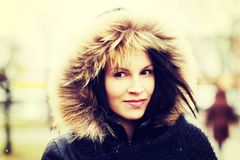 Young woman in furry hood. Stock Image
