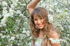 Young woman in the garden Stock Photography
