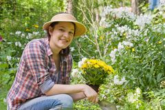 Young woman in a garden Stock Photography