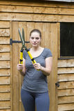 Young woman with garden pruner in garden Royalty Free Stock Images