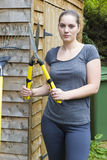 Young woman with garden pruner in garden Stock Photography