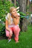 Young woman gardener with rakes stock image