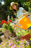 Young woman gardener working with flowers Stock Photography