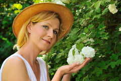 Young woman gardening. Taking care of snowball Royalty Free Stock Image