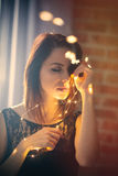 Young woman with garland Royalty Free Stock Images
