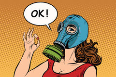 Young woman in gas mask okay gesture Stock Images