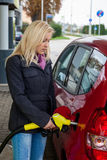 Woman at gas station to refuel Royalty Free Stock Photos