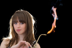 Young woman with a gas torch Stock Photography